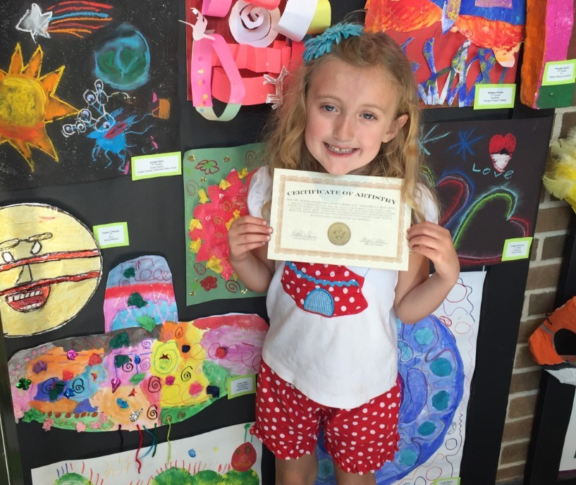 Kindergartner Leah Carr shows off her art!